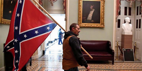 Confederate flag insurrectionist and his son allowed to take family road trip: judge