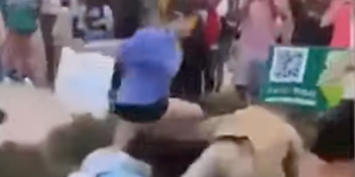 WATCH: Preacher with sign saying 'women belong in the kitchen' gets decked by college student