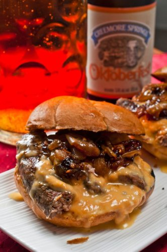 Bratwurst sandwich with beer braised onions and beer cheese sauce | Raymond's Food