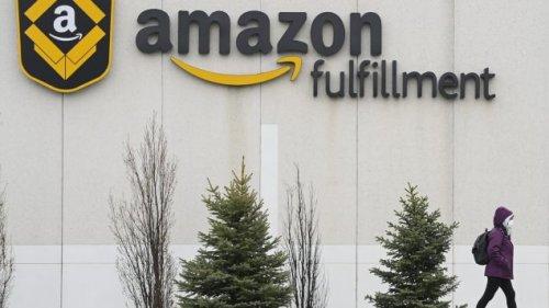 A person walks past an Amazon Fulfillment Centre in Brampton, Ont.