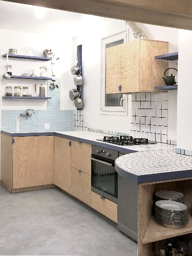 Stylish, Fresh, and Affordable: A Kitchen Built from Surplus Tiles
