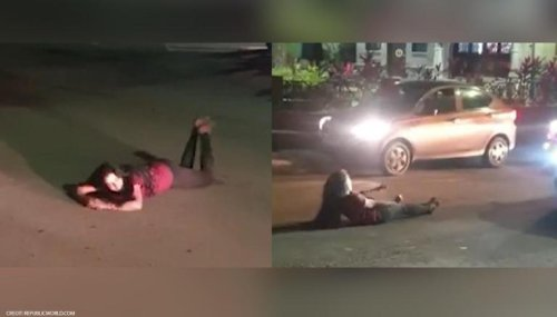 Pune: Intoxicated woman blocks traffic by lying on road, video goes viral on social media