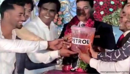 Telangana: Congress leader gives 5 litres of petrol to friend from TRS as wedding present