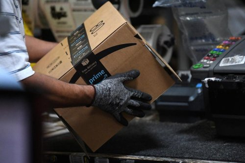 Exclusive: Amazon rolls out machines that pack orders and replace jobs