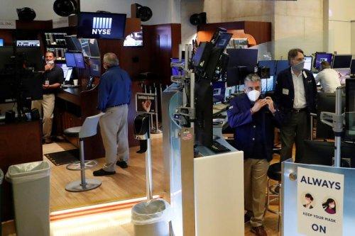 Stocks rally on quick economic revival hopes, oil slides