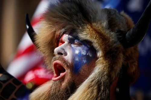 Fact check: Man with painted face wearing fur and horns rallied for Trump and QAnon, not Antifa or BLM