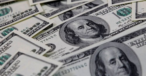 Dollar hovers near one-month low amid subdued U.S. debt yields
