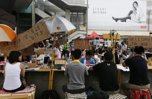 Hong Kong's leader warns protesters as tent city sprouts up