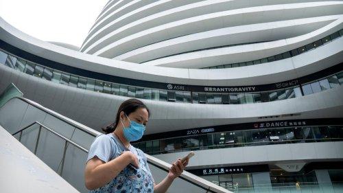 Covid en Chine: le retour des masques et du «pass sanitaire» dans les mégalopoles