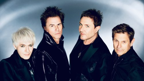 Duran Duran Rage With Queen Elizabeth, Lady Gaga Lookalikes in New 'Anniversary' Video