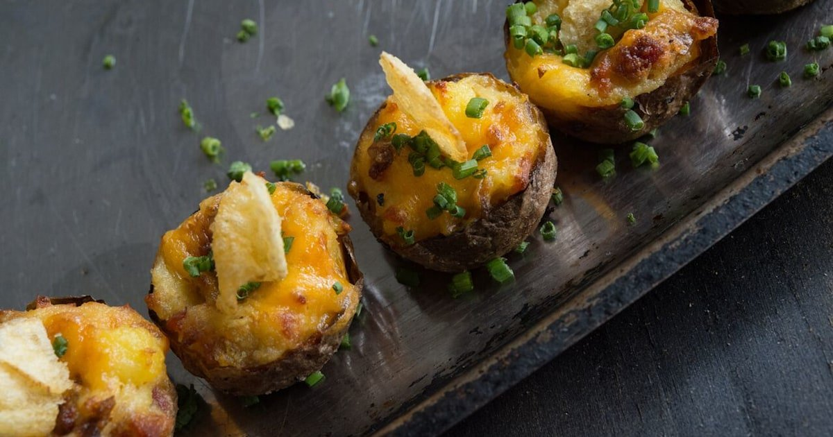These twice-baked potato bites are loaded with bacon and gooey cheddar