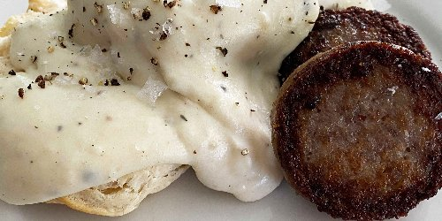Dolly Parton serves her creamy milk gravy with sausage patties and biscuits