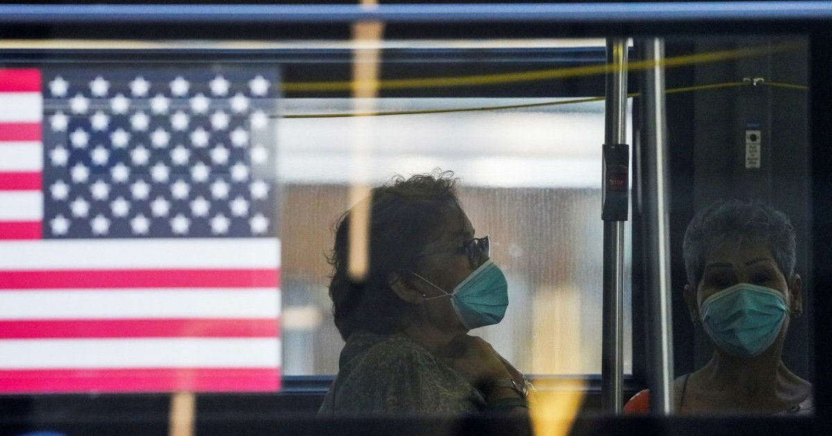 Even for vaccinated people, now is the time for masks and testing, public health experts say