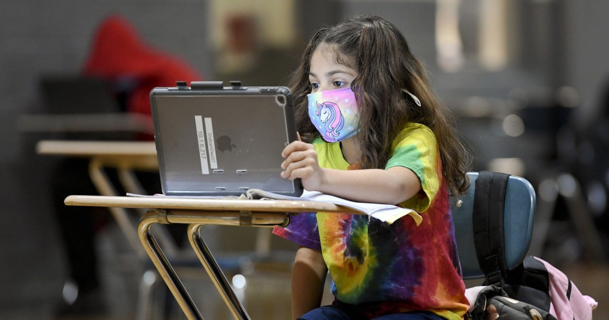 All children should wear masks in school this fall, even if vaccinated, according to pediatrics group