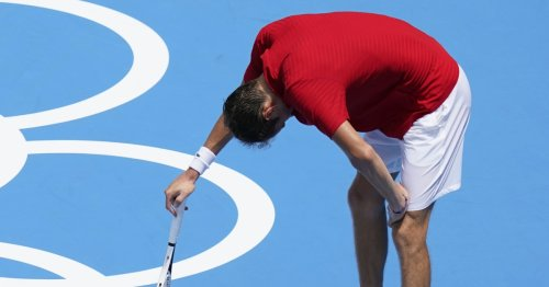 Tennis star says he could 'die' in Tokyo heat, another leaves court in a wheelchair
