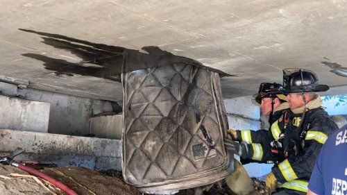 Sacramento firefighters called to put out overpass fire, find someone was living inside panel