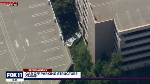 Driver dies after four-story plunge from parking garage, California police say