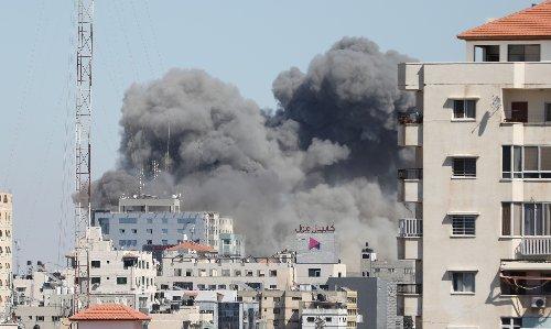 Israeli airstrike levels AP, Al Jazeera office building on live TV