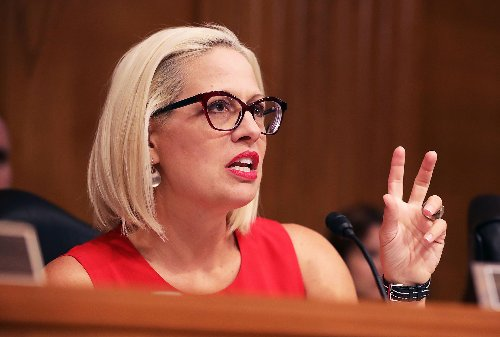 Sinema slammed for taking donations from banks, debt collectors after opposing minimum wage increase