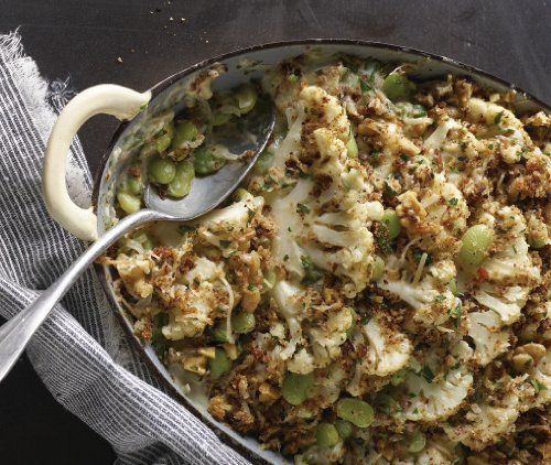 This cheesy and creamy cauliflower and lima bean gratin features vegetables baked to perfection