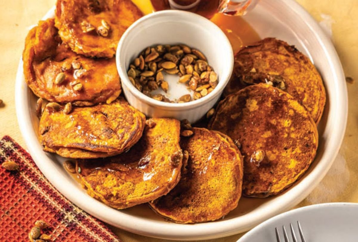 Top these pumpkin cornmeal cranberry pancakes with candied pecans