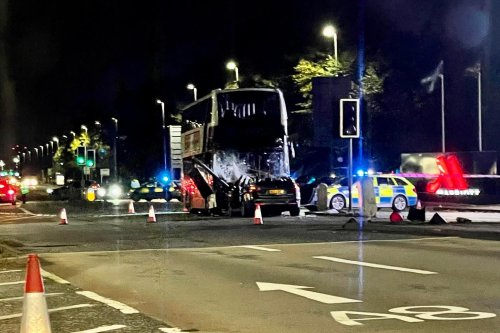 Driver left with 'potentially life-changing injuries' after car and bus collision in Edinburgh