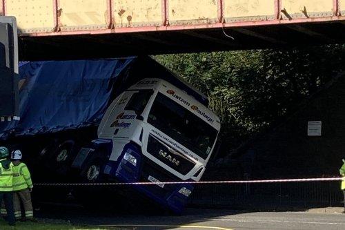 Lorry crashes into bridge causing road closure and 'huge tailbacks' in Edinburgh