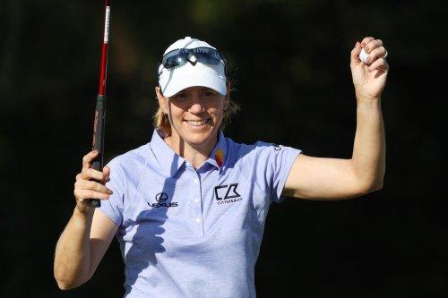 Annika Sorenstam teeing up in Scandinavian Mixed event along with Henrik Stenson