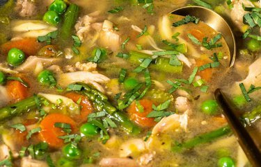 A chicken and orzo soup that's fresh enough for spring, with leeks, peas and asparagus
