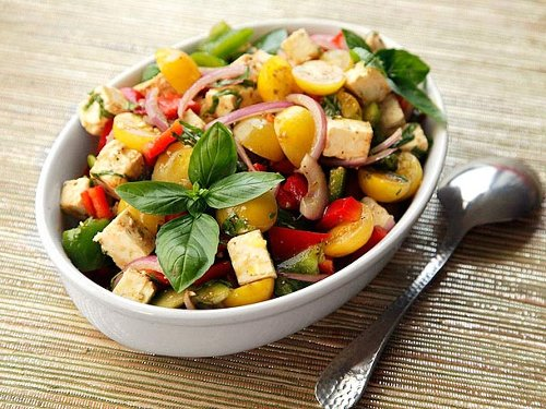 Mediterranean Chopped Salad With Tomatoes, Peppers, Feta, and Basil Recipe