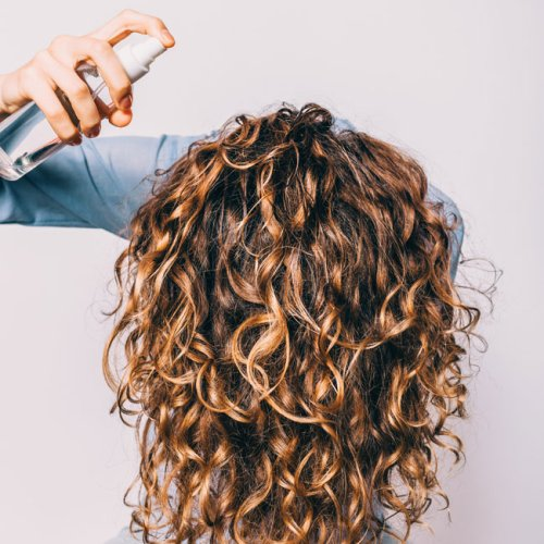 The Only Product You Should Be Using For Frizzy Hair This Summer, According To Stylists