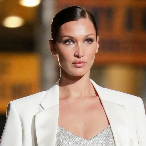 Bella Hadid Is Barely Covered In This Plunging Black Dress For New York Fashion Week–Her Curves Are Unreal!