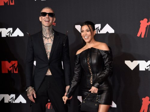 Kourtney Kardashian Celebrates Travis Barker Engagement with Topless Photos