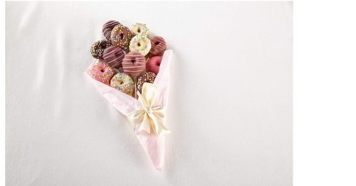 A bouquet of a dozen donuts dipped in chocolate