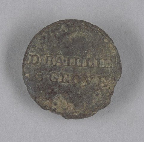 Identification button worn by enslaved persons on Golden Grove Plantation