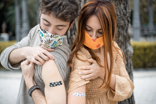 Meet the Young Adults Sneaking Behind Their QAnon Parents' Backs to Get Vaccinated