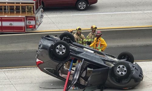 Car flips in crash on I-10 freeway slowing traffic