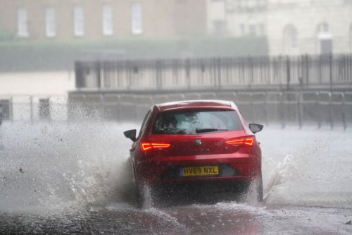 Homes, roads and hospitals flooded as storms batter England's south