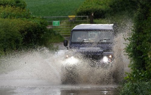 UK weather: Downpours as flood alerts remain in place