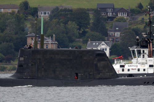 Wallace attempts to downplay submarines row as France minister postpones meeting