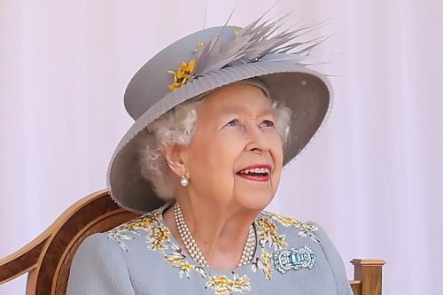 Queen beams as she watches mini Trooping of Colour at Windsor