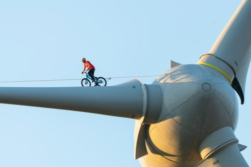 Pro-cyclist performs stunt on wind turbine to raise awareness of climate change