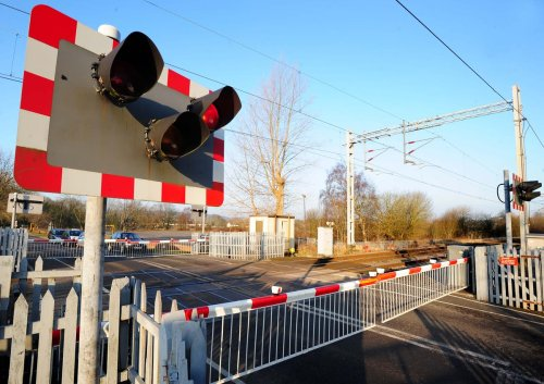 Railway lines blocked after train hits car at level crossing