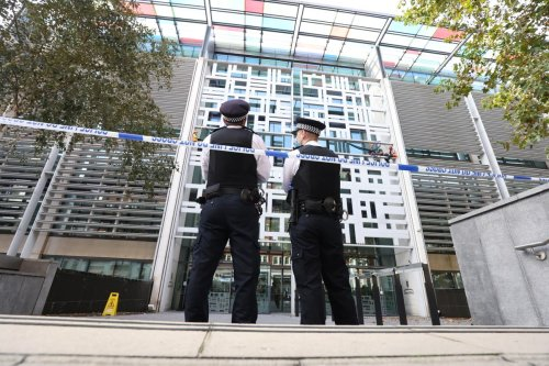 Four charged after Defra building scaled in animal farming protest