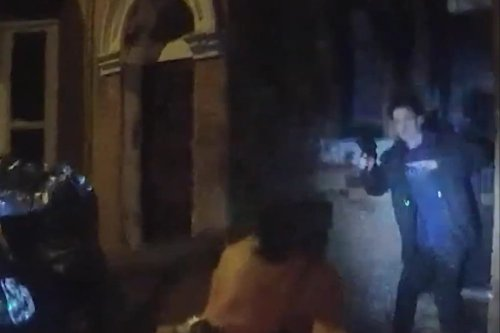 Shocking moment suspect points gun at police officer's face