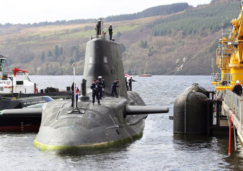 France accuses Britain of hiding in 'American lap' in submarine row