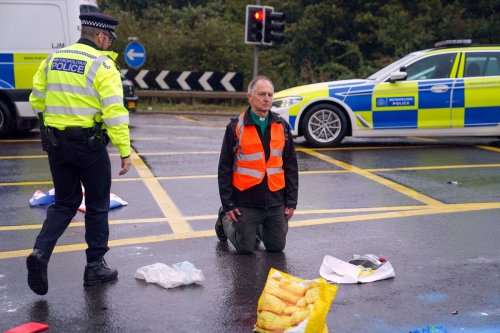 Revealed: Vicar in dog collar defies church's order by blocking up M25