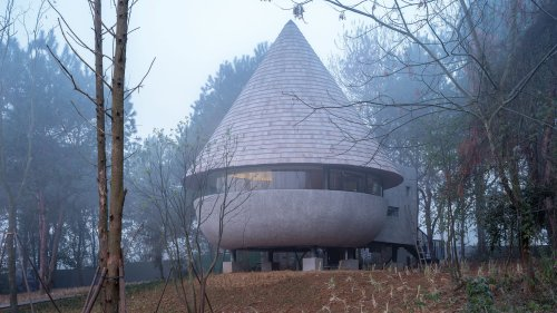 The Mushroom by ZJJZ is a cone shaped guest house in the woods of Jiangxi China