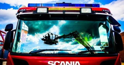 Woman taken to hospital following house fire