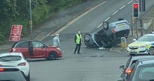 Woman taken to Royal Stoke after car overturns